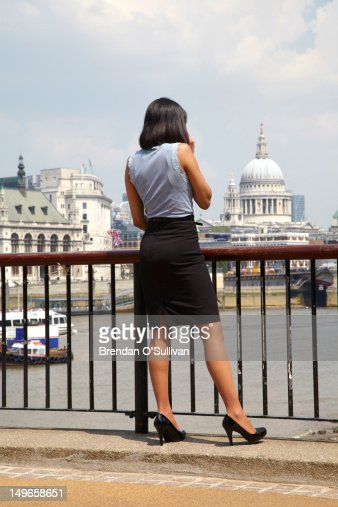 Woman on phone on London's Southbank : Stock Photo