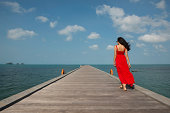 Woman on pier, Taling Ngam Beach, Ko Samui, Thailand