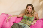 Woman on pink cushions