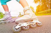 Woman on roller skates riding outdoors