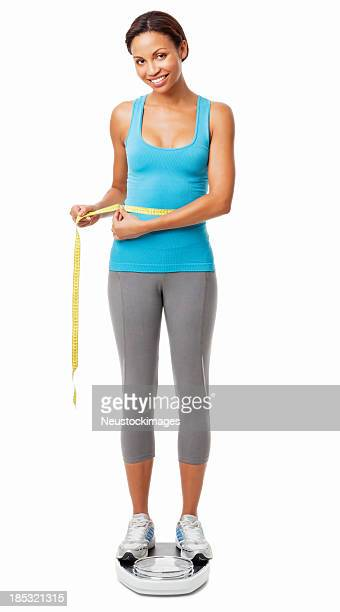 女性彼女のウエストラインのスケールの測定で絶縁