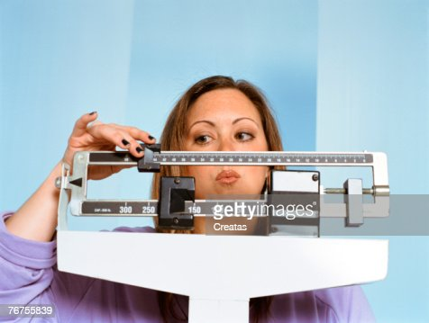 Woman on scale : Stock-Foto