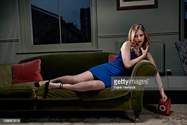 Woman on sofa with phone