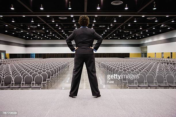Woman on Stage in Empty Auditorium