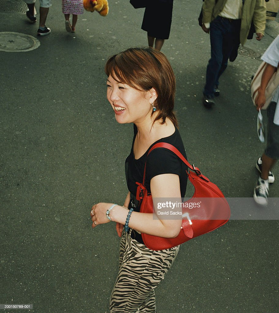Woman on street laughing, elevated view : Stock Photo