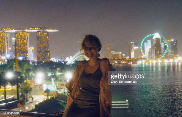 Woman on the background of Marina Bay in Singapore at the evening