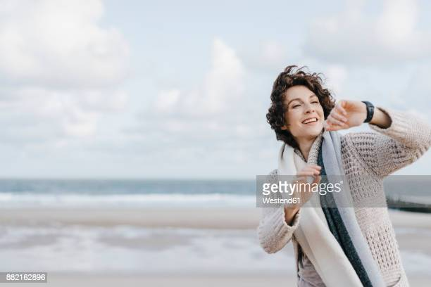 Woman on the beach looking at her smartwatch