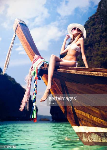 Woman on the longtail boat