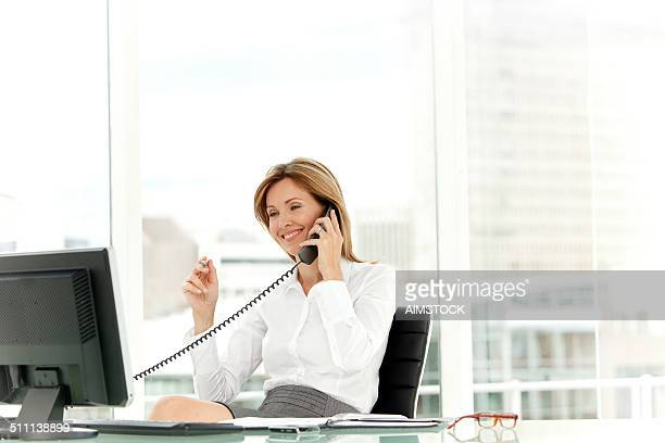 Woman on the phone at workplace