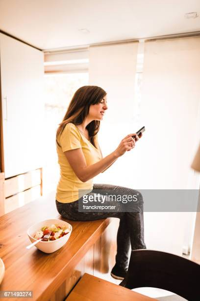 woman on the phone in the kitchen