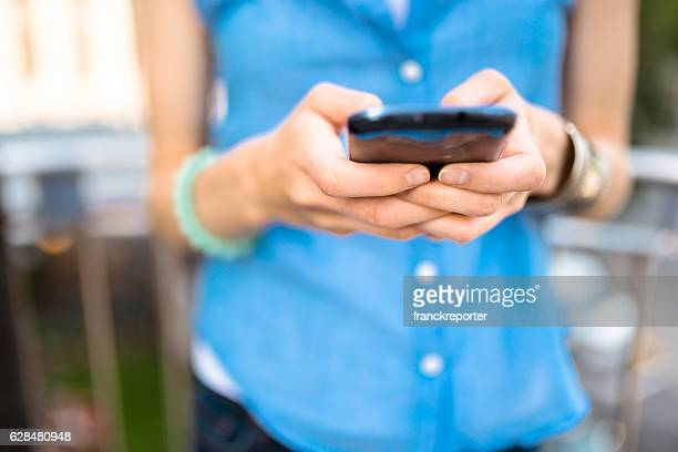 woman on the phone sitting in montreal text messaging