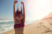 Woman on the tropical beach enjoying life.