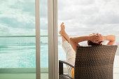 'Woman on Vacation, Enjoying Hotel Room Balcony View'
