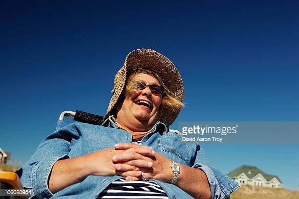 A woman on vacation, laughing.