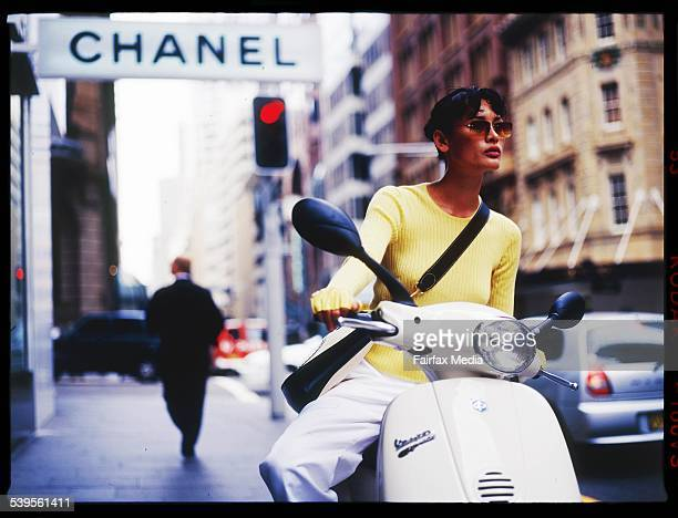 Woman on Vespa scooter outside the Chanel store on Castlereagh Street in Sydney 12 April 2002 AFR GENERIC Picture by JESSICA HROMAS