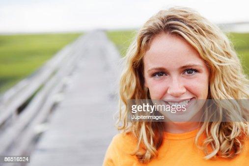 Woman on walkway in marshland : Stock-Foto