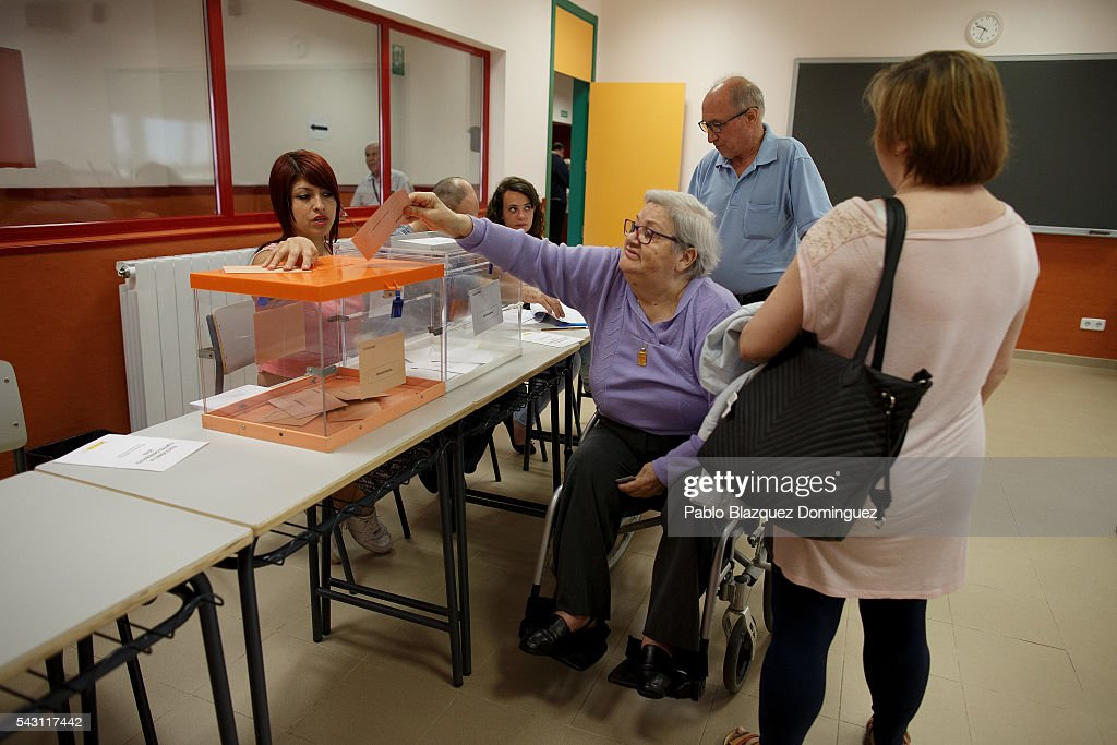A woman on wheelchair casts her vote during the Spanish General Elections on June 26, 2016 in Madrid, Spain. Spanish voters head back to the polls after the last election in December failed to produce a government. Latest opinion polls suggest the Unidos Podemos left-wing alliance could make enough gains to come in second behind the ruling center right Popular Party.