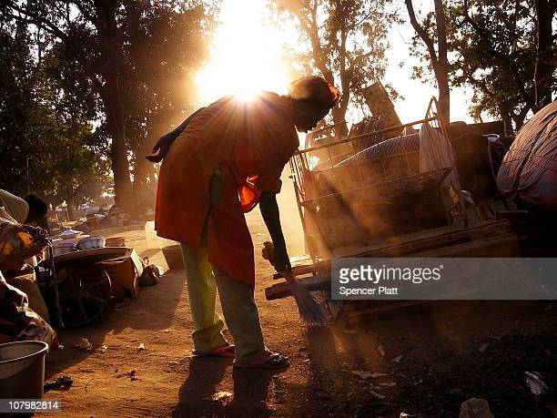 A woman one of hundreds of internally displaced south Sudanese who have recently returned from the north of the country sweeps up around her...