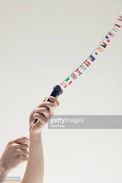 woman opening a party popper,hands close-up