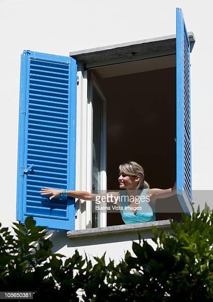 woman opening a window