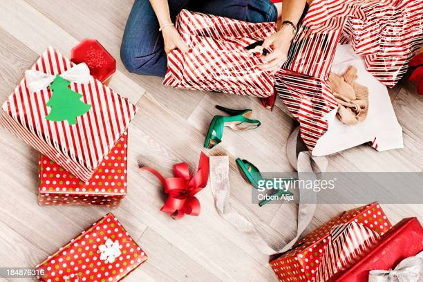 Woman opening christmas presents