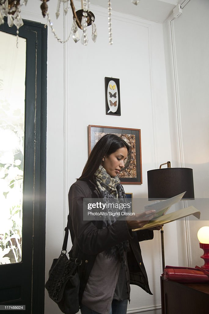 Woman opening her mail : Stock Photo