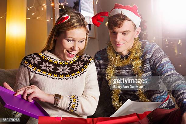 Woman opening present at Christmas.