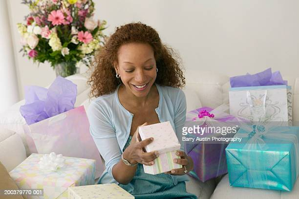 Woman opening present, smiling