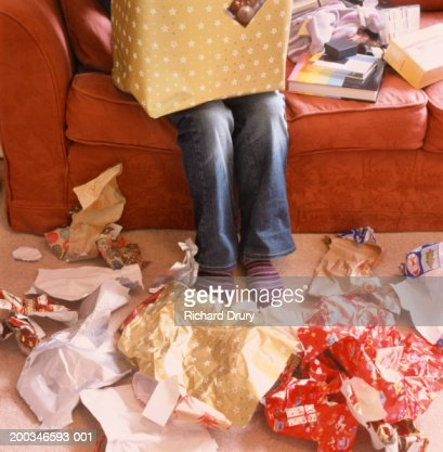 Woman Opening Presents Wrapping Paper On Floor Low Section