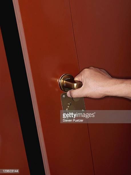 Woman opening red door