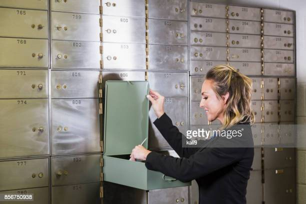 Woman opening safety deposit box