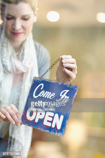 Woman opening shop : Stock Photo