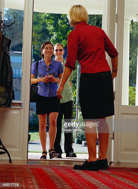 Woman Opening the Door for Visiting Friends