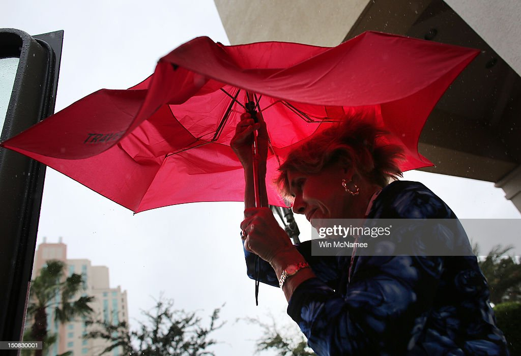A woman opens her umbrellaas it rains before the start of the abbreviated first day of the Republican National Convention outside the Tampa Bay Times Forum on August 27, 2012 in Tampa, Florida. The RNC is scheduled to convene today, but will hold its first full session tomorrow after being delayed due to Tropical Storm Isaac.