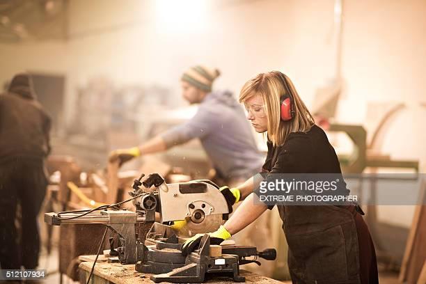 Woman operating on circular saw