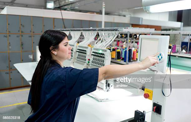 Woman operating the embroidery machine