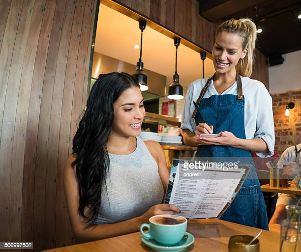 Woman ordering at a cafe