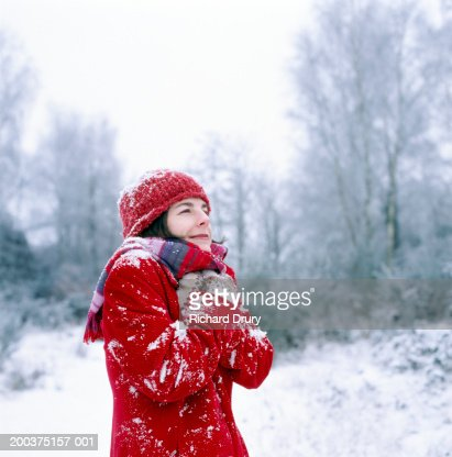 Woman outdoors, hands to chest, winter : Stock Photo