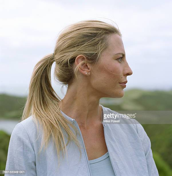 Woman outdoors, profile