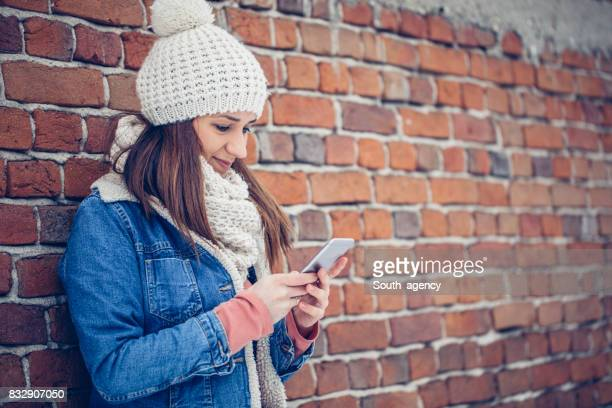 Woman outdoors texting
