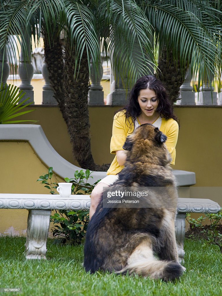 woman outdoors with her dog : Stock Photo