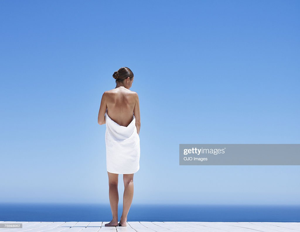 Woman outdoors with ocean backdrop : Stock Photo
