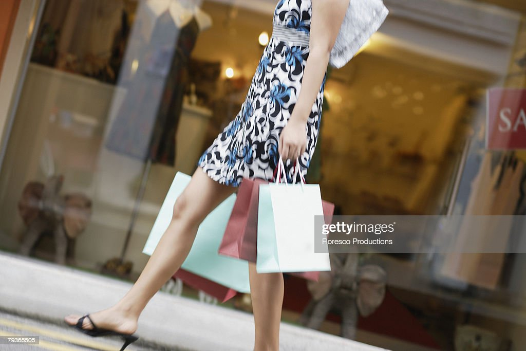 Woman outdoors with shopping bags : Stock Photo