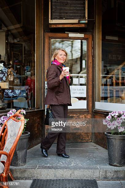 Woman outside coffee shop