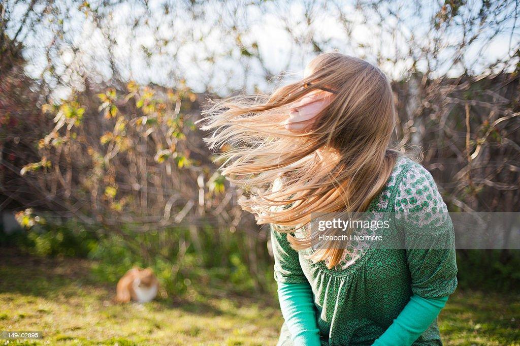 Woman outside in wind : Stock Photo