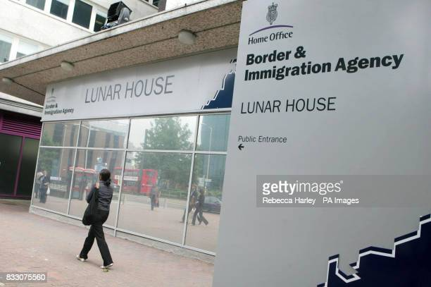 A woman outside Lunar House the Home Office Border and Immigration Agency West Croydon London