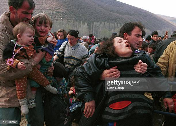 A Woman Overcome By Heat Gets Assistance At Blace Macedonia April 6 At The Border With Kosovo Where An Estimated 40000 Kosovo Alabanian Refugees Have...