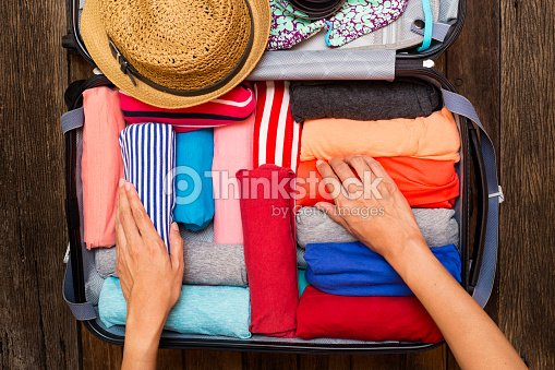 woman packing a luggage for a new journey : Stock Photo