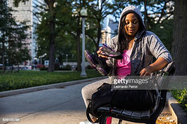 Woman packing after working out in the city
