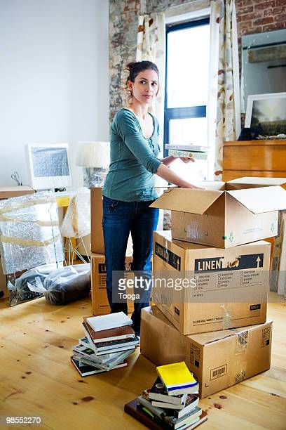 Woman packing up books in boxes